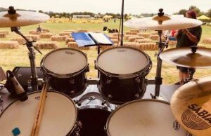 A drum set faces a field